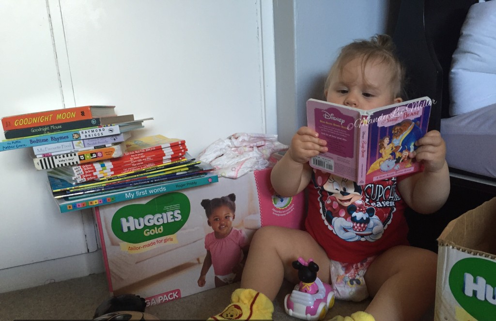 Charly reading Disney with #HuggiesGold