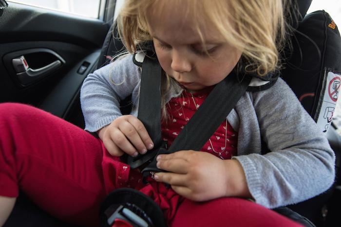 Hijacking car seat release